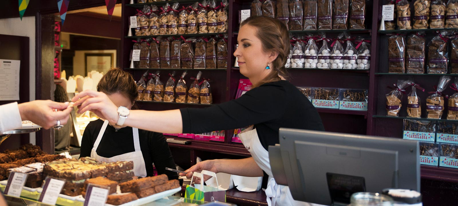 Shop staff member serving a customer